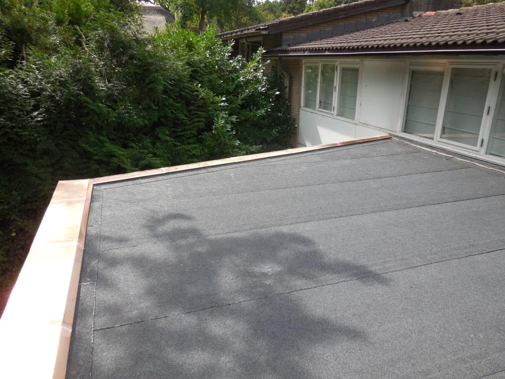 Juliana van Stolberglaan, Aerdenhout – Vervanginging bitumen dak met isolatie en koperen deklijst